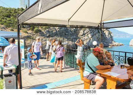 Yalta, Crimea - 11 July, People on the observation deck, 11 July, 2017. Small Castle Lastochkino Nest and its surroundings.