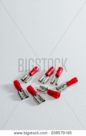 A Studio Photograph of Red Female Spade Terminals
