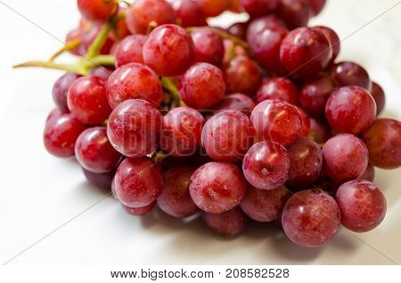 A Studio Photograph of a Bunch of 'Flame' Variety (Vitis Vinifera) Grapes