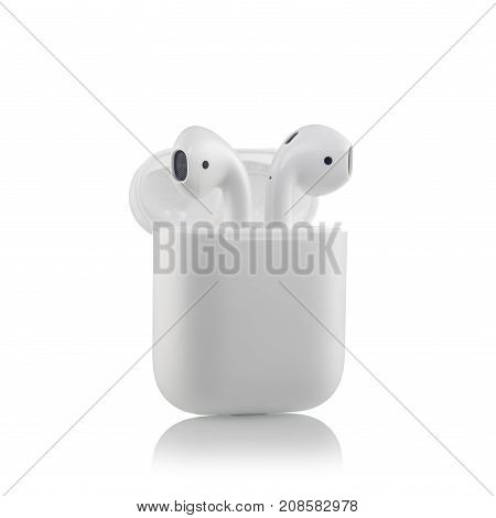 Moscow, Russia - October 07, 2017: Apple Airpods Wireless Bluetooth Headphones Unboxing With A Micro