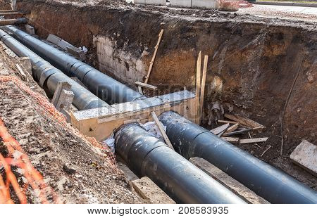 Repair work of heating duct. Replacement pipes of the heating main in summertime