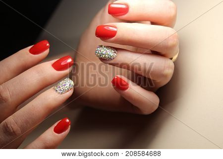 Manicure Design Is Bright Red And Rhinestones
