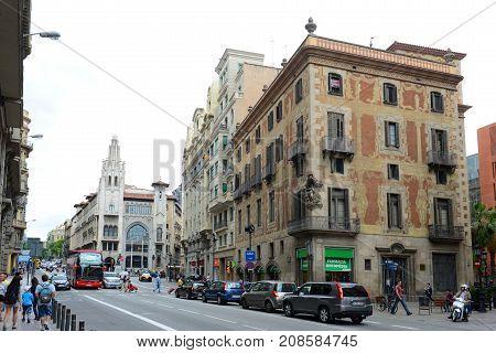 BARCELONA - JUN. 9, 2013: 18th Historic building Casa dels Velers (near) and Edifici de la Caixa de Pensions (far) at Via Laietana in the Old City (Ciutat Vella) of Barcelona, Catalonia, Spain.