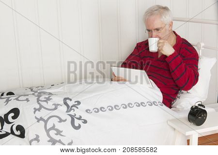 Waking up in the morning with reading the newspapers on tablet