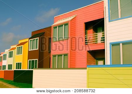 Brightly pastel painted condominiums line the beachfront