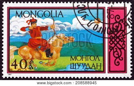MONGOLIA - CIRCA 1987: a stamp printed in Mongolia shows Shooting Bow Traditional Equestrian sports circa 1987