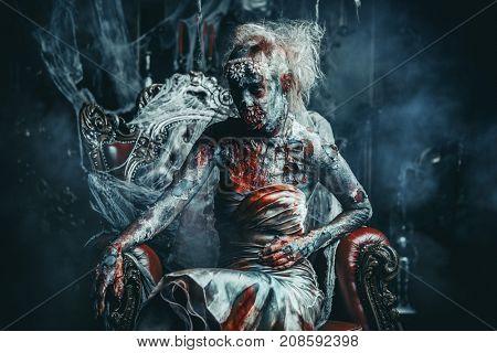 Zombie bride. Bloody dead bride woman in the old abandoned castle. Halloween. Horror.