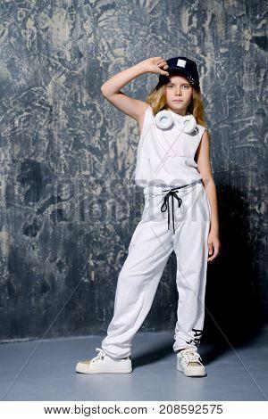 Cool modern girl dancing hip-hop. Children's fashion.