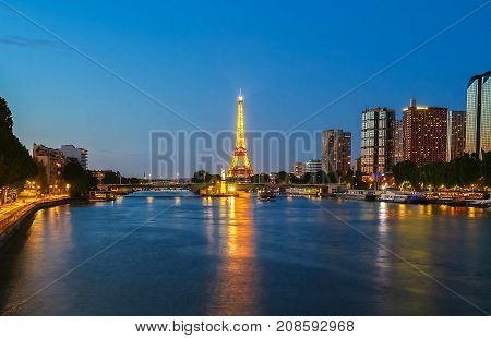PARIS - 07 JULY, 2017: Eiffel Tower in the Dusk on July 07, 2017. The Eiffel tower is the most visited monument of France located oh the bank of Seine river in Paris, France.