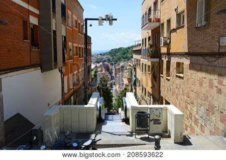 BARCELONA - JUN. 10, 2013: Baixada de la Glòria is a mountain road to Park Güell in  the Gràcia district of Barcelona, Catalonia, Spain.