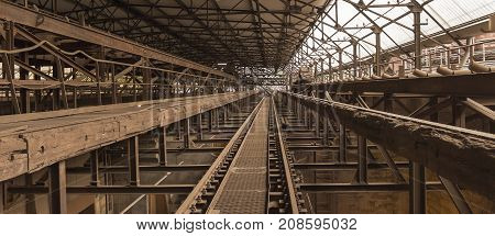 weathered rusty industrial scenery with old rundown steel girders and appliances