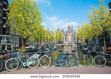 Amsterdam Netherlands - April 20 2017: Bikes on the bridge in Amsterdam. Canals of Amsterdam Netherland