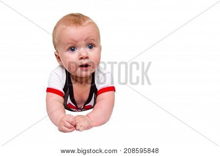 Photo of a smiling baby smiling Portrait of a boy lying on his stomach. white background isolate.