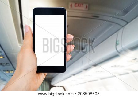Close-up Of Person's Hand Using Mobile Phone With Blank Screen In Airplane