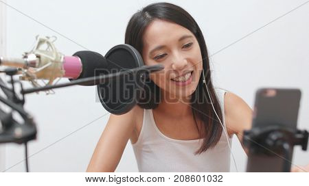 Woman talking on cellphone with live stream