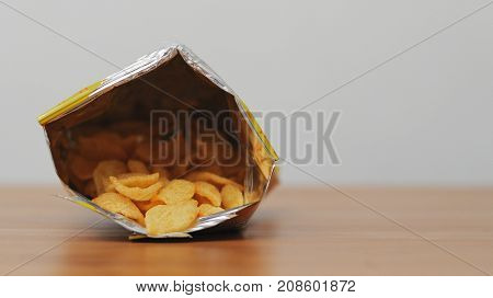 Taking Cheese crisp from pack