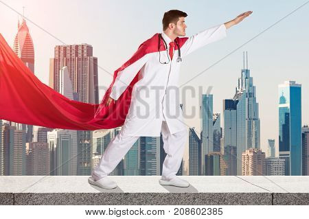 Young Superhero Doctor In Red Cape Against City Skyline