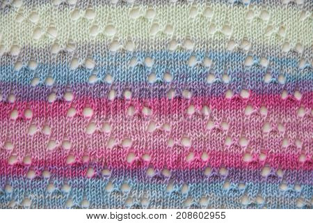 White, Pink And Violet Knitted Fabric Texture
