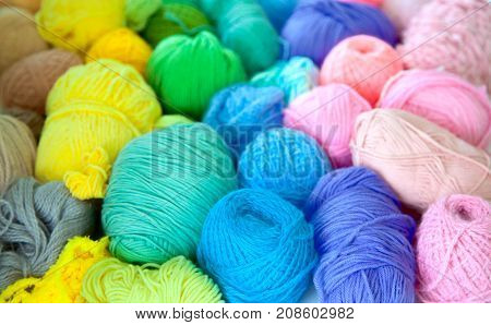 colored woolen yarn. Accessories for needlework. White background