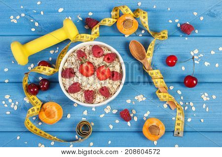 Oatmeal With Fruits, Tape Measure And Dumbbells, Concept Of Slimming, Sporty Lifestyle And Healthy N