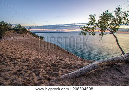 Sleeping Bear Dunes National Lakeshore. Massive sand dune at sunset on the shores of Lake Michigan in the Sleeping Bear Dunes National Lakeshore in Michigan.