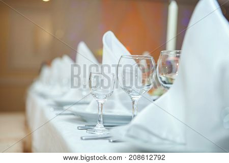 Wedding decorations glasses and napkins on a table
