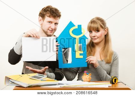Young Couple With House And Paper.