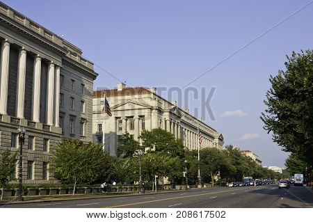 Washington, DC - September 14, 2009 -- Wide view of the stately building architecture on a main street in Washington, set against a blue sky on sunny afternoon in September.
