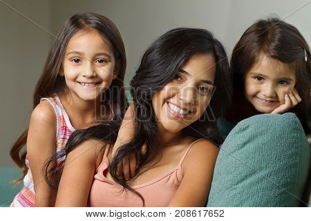 Portrait of a young mother and her two daughters.