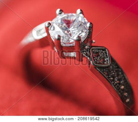 Closeup of diamond ring in red velvet box macro