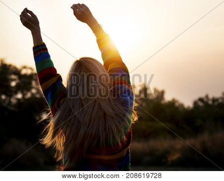 Silhouette of a girl stretching in the morning