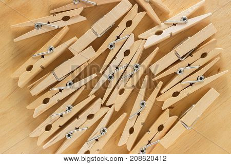 The background of a number of wooden clothespins on a wooden table