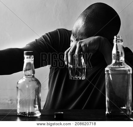 African American man drinking alcohol