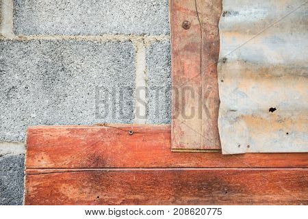 the gray brick and  wood and galvanized iron sheets old wall. For wallpaper.