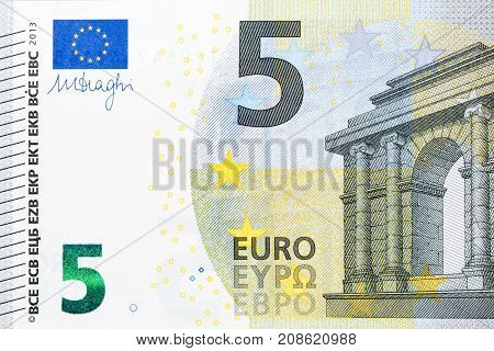 Photo of five euro banknote in macro shot. High resolution photo.