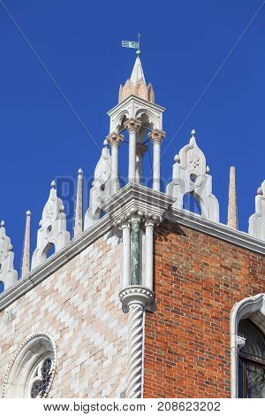 Doge's Palace on Piazza San Marco decorative facade Venice Italy. The palace was the residence of the Doge of Venice the museum is currently located here