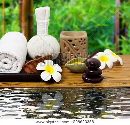 Spa concept with flowers on old wooden . Spa. Spa treatment. Spa massage