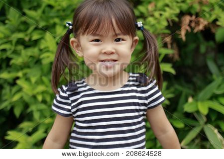 little smiling Japanese girl (2 years old)