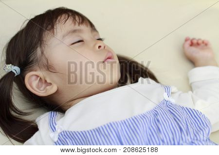 little sleeping Japanese girl (2 years old)