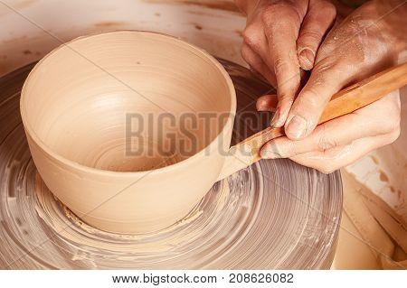 Close-up Of A Woman  Sculpts  Clay Vase