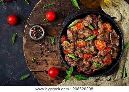 Chicken Liver (offal) With Onions And Tomatoes In A Frying Pan In Armenian. Flat Lay. Top View