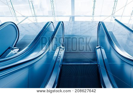 high angle view of empty escalator,blue toned.