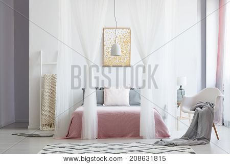 White Chair In Canopy Bedroom