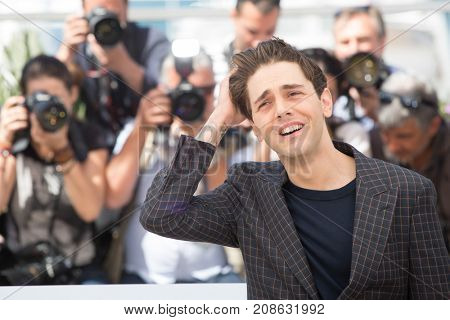 CANNES, FRANCE - MAY 19, 2016: Xavier Dolan attends the 'It's Only The End Of The World (Juste La Fin Du Monde)'  photocall during the 69th annual Cannes Film Festival at the Palais des Festivals