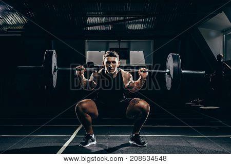 Sportsman Lifting A Barbell