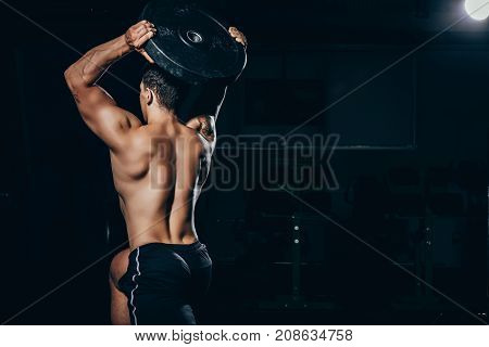 Sportsman Holding Barbell Weight