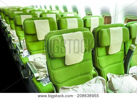 Green Airplane seats in cabin. Interior view