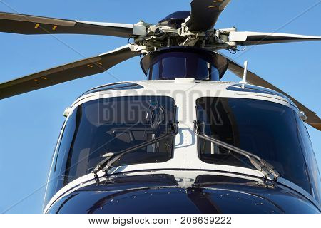 Exterior Front View Of Helicopter Cockpit And Rotor Blades