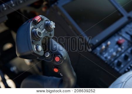 Close Up Of Joystick In Helicopter Cockpit