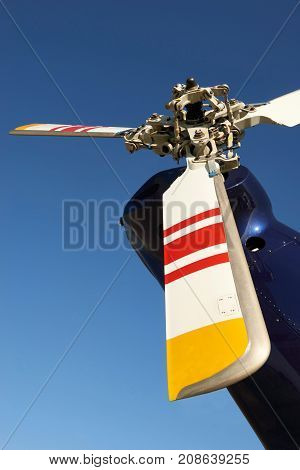 Tail Rotor Of Helicopter Against Blue Sky